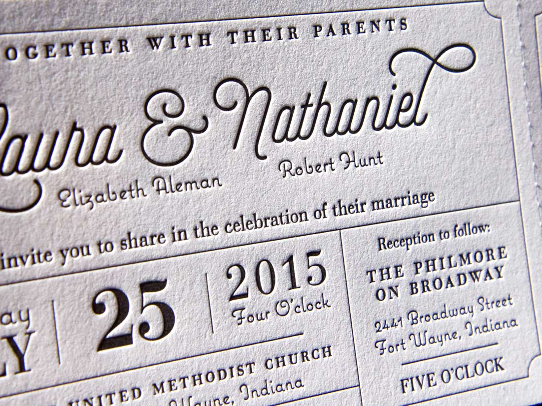 Close-up of letterpress wedding invitation, showing the texture of the print and paper