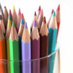 multicolored pencils in a glass cup