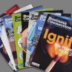 "Covers of multiple issues of the Irvine Chamber's ""Business Connection"" magazine fanned out"