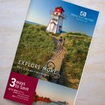 Cover of a Princess Cruises brochure for Canada & New England, featuring a young couple walking up a scenic path to a lighthouse