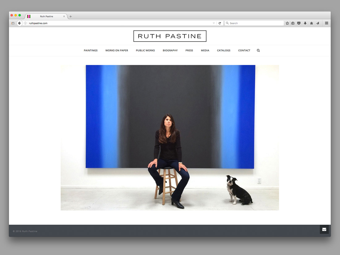 Home page on Ruth Pastine's website showing the artist perched on a stool in front of one of her paintings